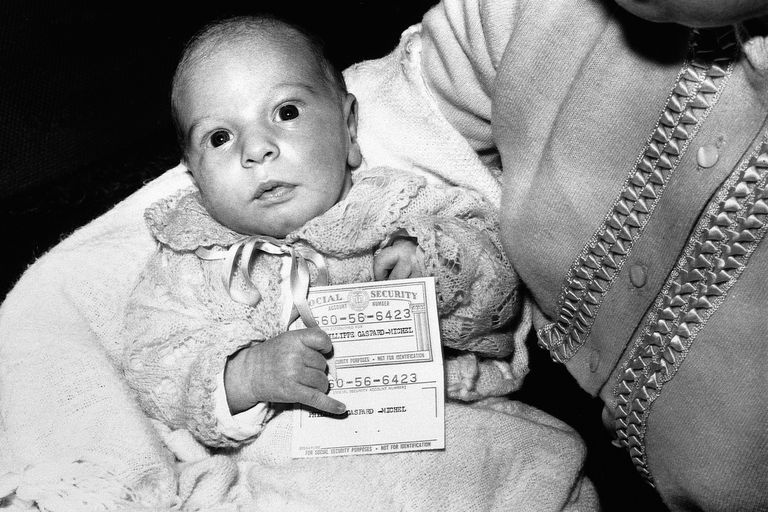 Baby holding Social Security card