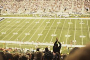 Fans cheering at football game