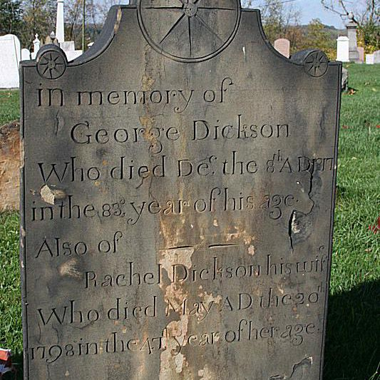 Photo of a wheel symbol on the tombstone of George and Rachel Dickson, Robinson's Run Cemetery, PA