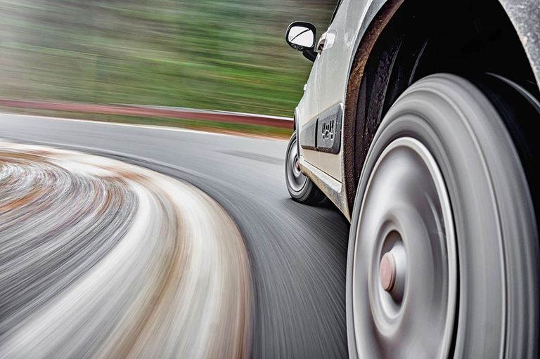 Stylized image of a car's wheels in motion
