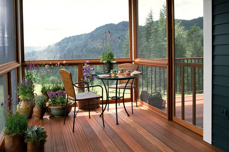 Wood Deck With Potted Plants And Furniture