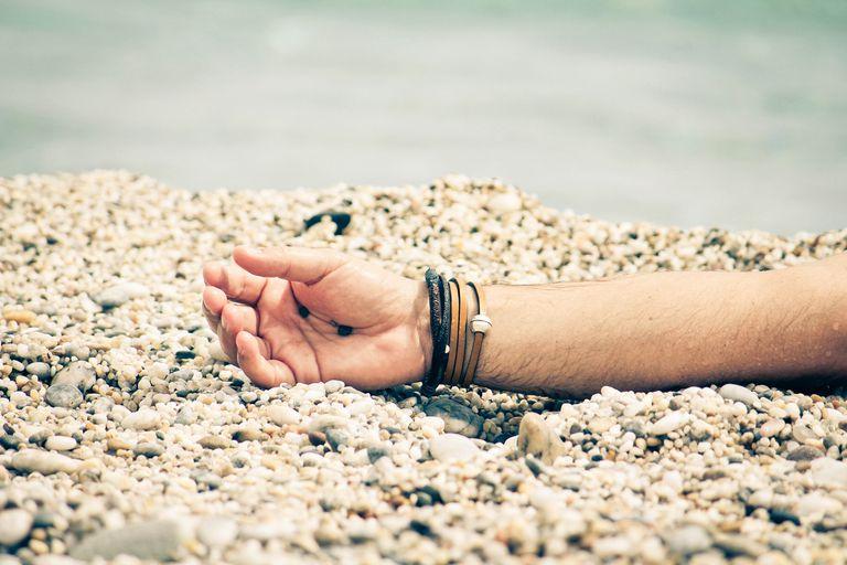 limp hand among stones