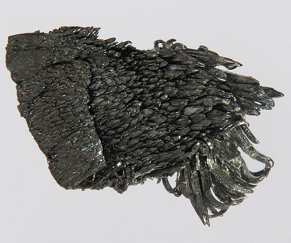 This is a photo of an ultrapure (99.99%) crystal of yttrium metal.