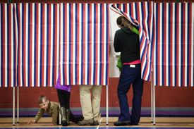 Voter entering U.S. voting booth