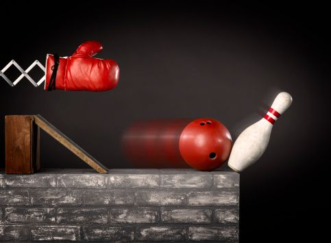 boxing glove hitting bowling ball and pin