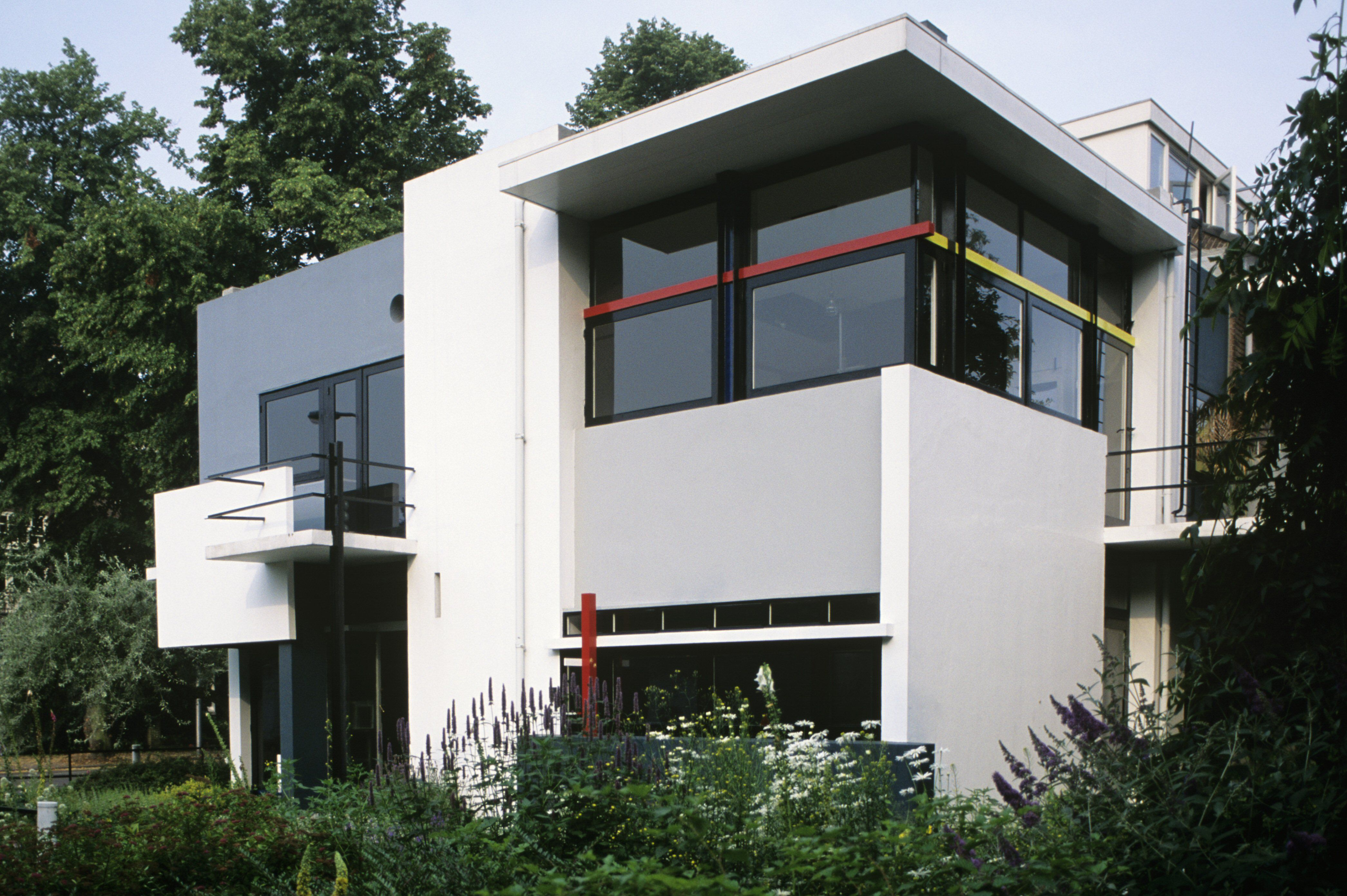 Photo of modern house of white painted concrete and glass