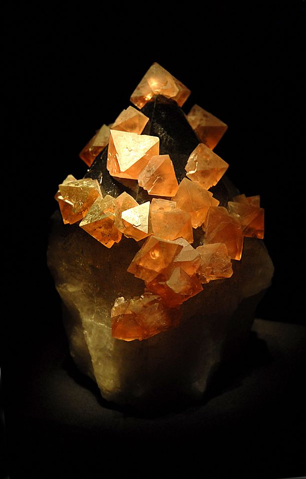 Fluorite or fluorspar is an isometric mineral composed of calcium fluoride.