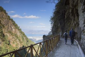 Two people hiking in Cang Mountains, Yunnan, China
