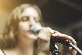 Singer rehearsing