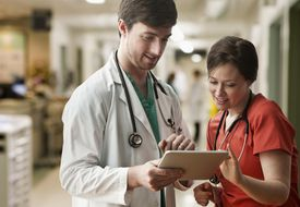 Doctor and nurse using tablet.
