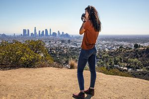Tourist in Los Angeles takes picture of the skyline