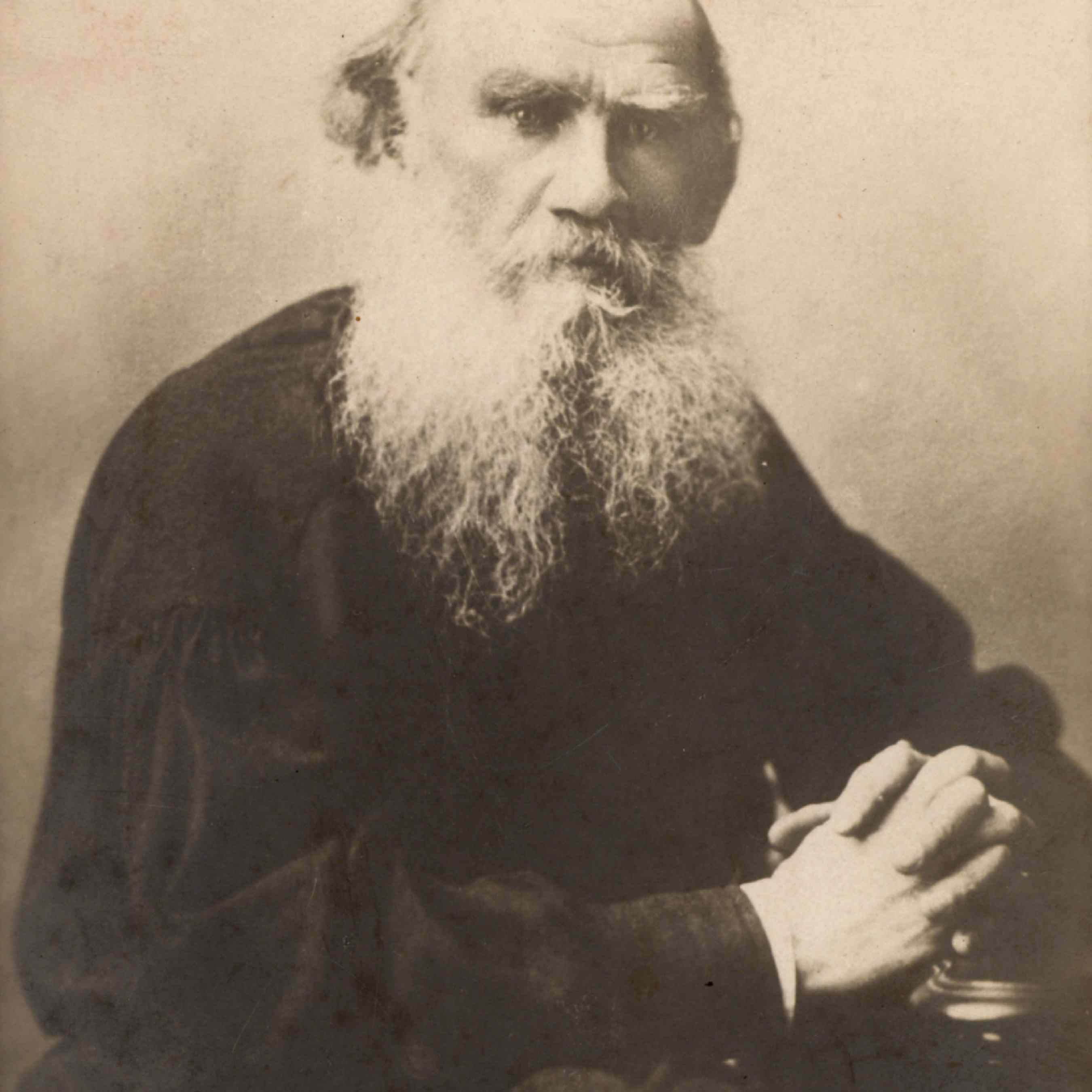 Sepia-toned portrait of an older Tolstoy
