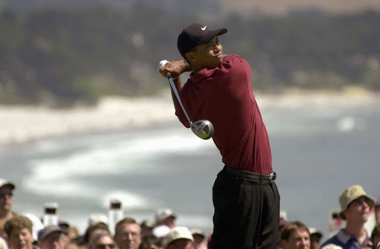 Tiger Woods tees off on the 14th hole during the final round of the 100th US Open on June 18,2000 in Pebble Beach, California