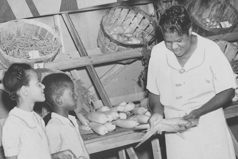 Nannie Helen Burroughs and children at farm stand