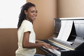 African woman playing piano