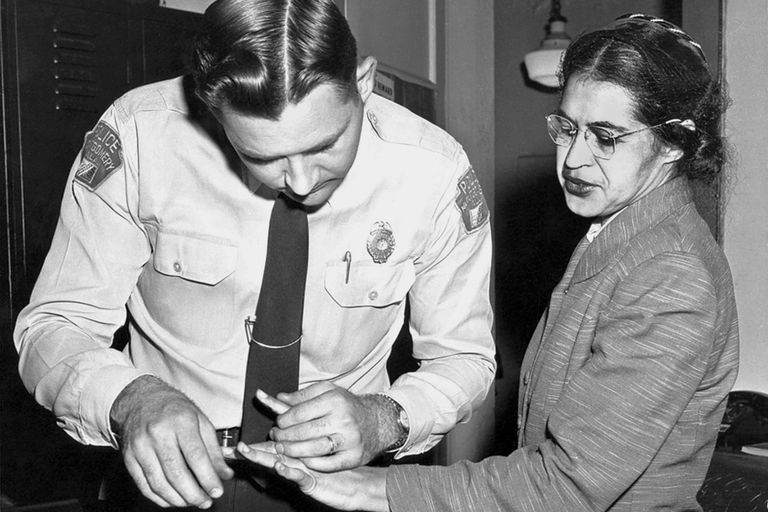 Rosa Parks being fingerprinted after she was arrested for not giving up her bus seat.