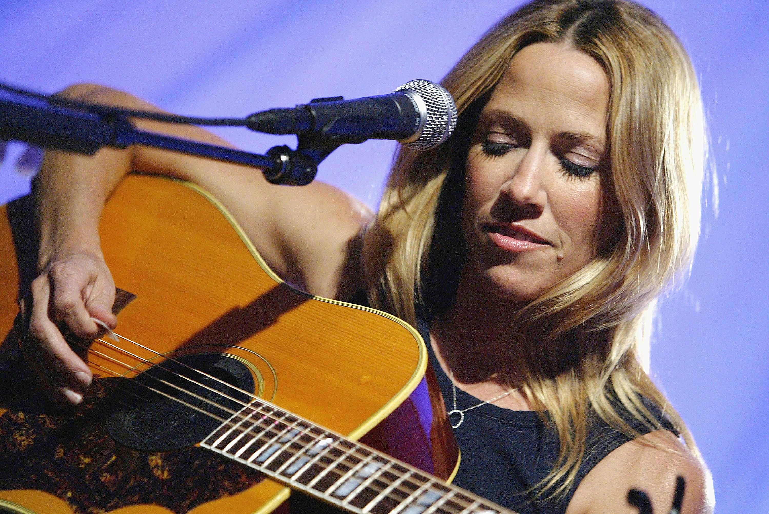 Sheryl Crow Performing with a Guitar