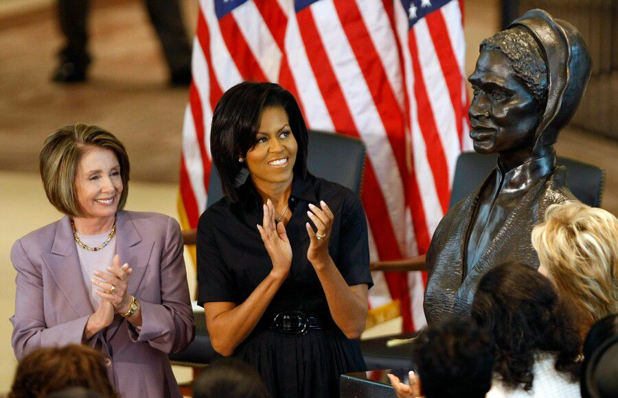 Michelle Obama and Nancy Pelosi look on as a memorial bust of Sojourner Truth is unveiled.