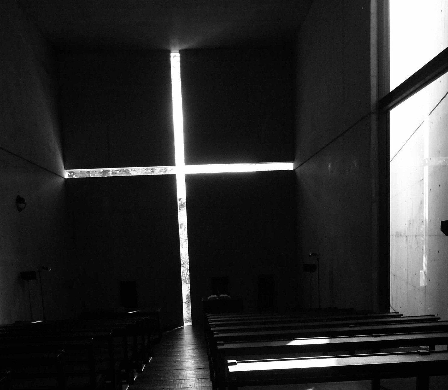 Light comes through large cross in wall of Church of the Light, 1989 Japan, Designed by Tadao Ando