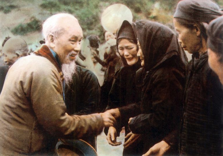 Ho Chi Minh (1890-1969) founder of Indochinese communist party, greets people