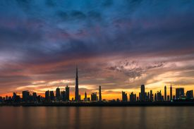 tall buildings against an evening sky