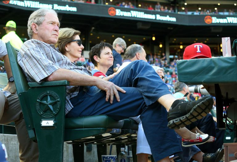 Former President George W. Bush and former First Lady Laura Bush watch a baseball game