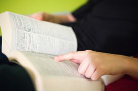 a person reading a dictionary