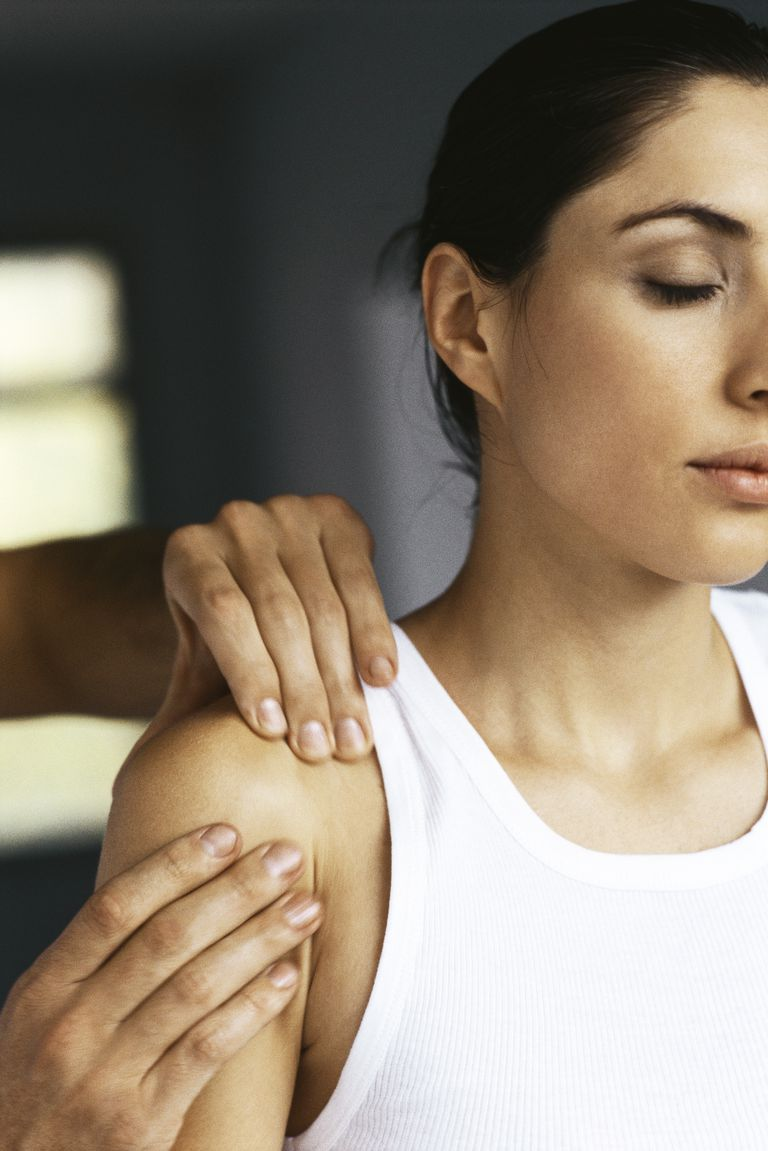 Woman having shoulder massaged