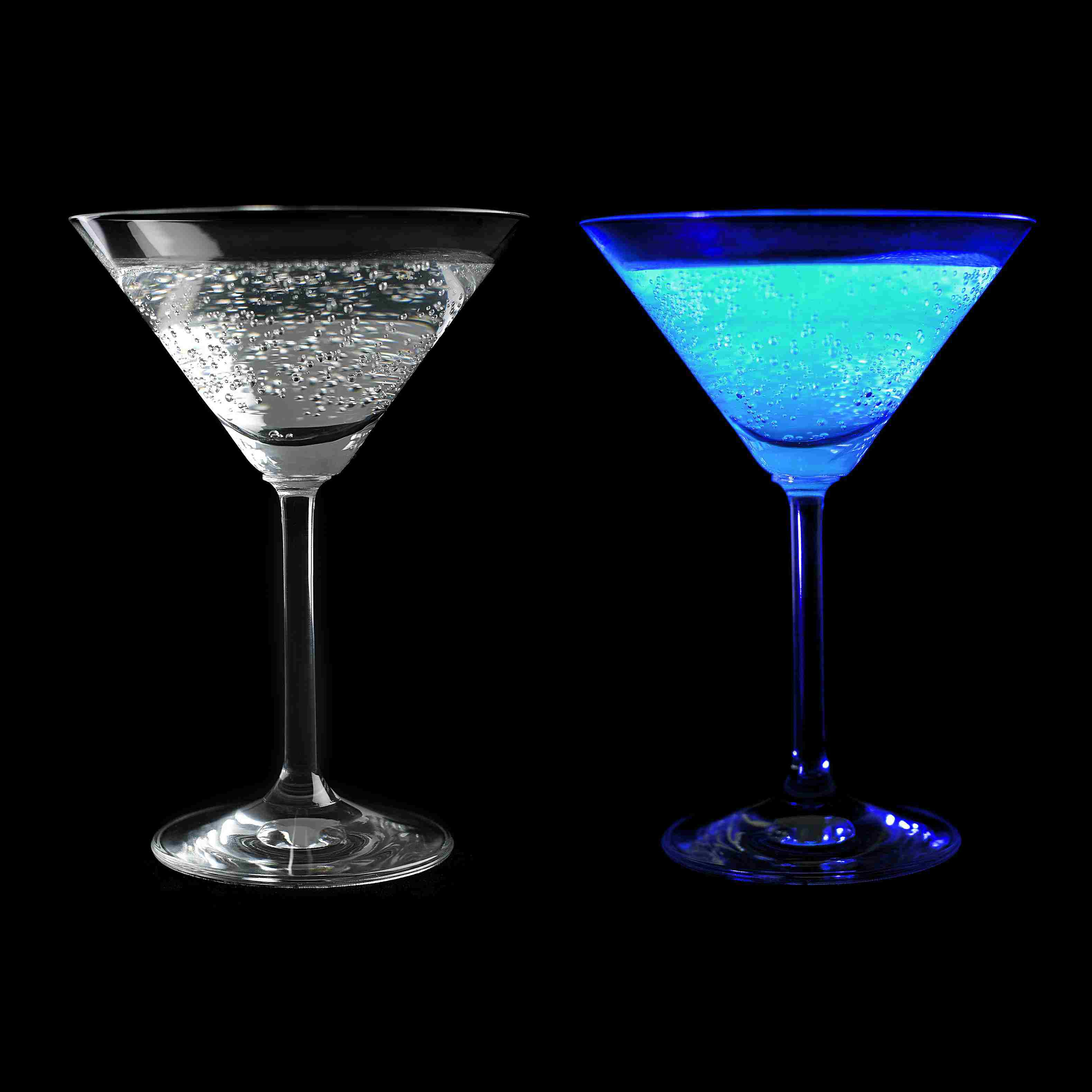 Tonic water is clear under ordinary light, but glows aqua blue under black or ultraviolet light.