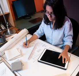 Young woman in design office working