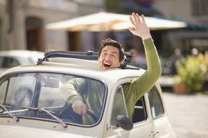 Italian man waving from Fiat