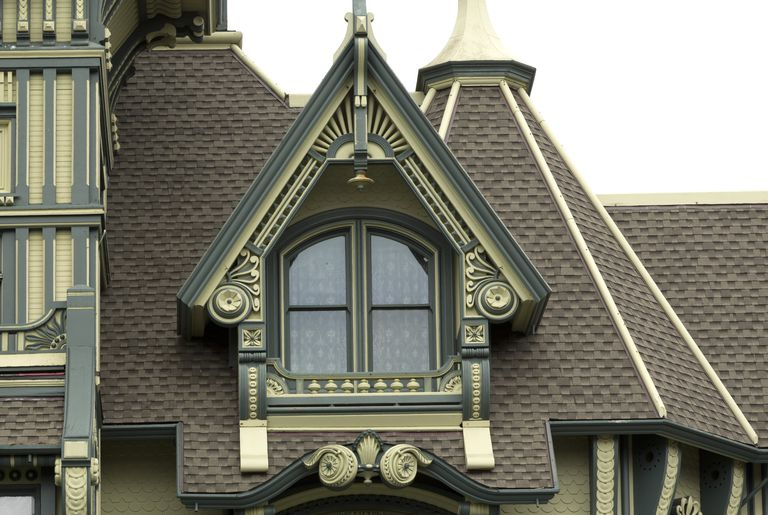 Ornate Gable Dormer In Green And Cream Colors Double Arched Windows On Steep Roofed