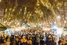 People walking at La Rambla street during Christmas and New Year holidays in Barcelona, Catalonia, Spain