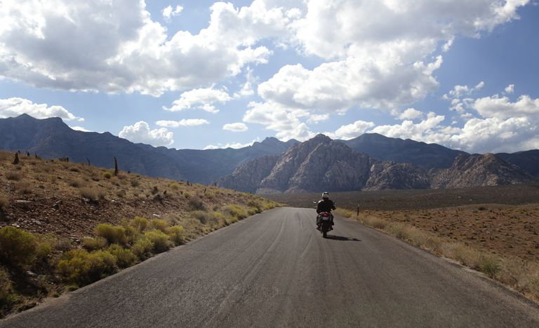 A motorcycle rider on an open road