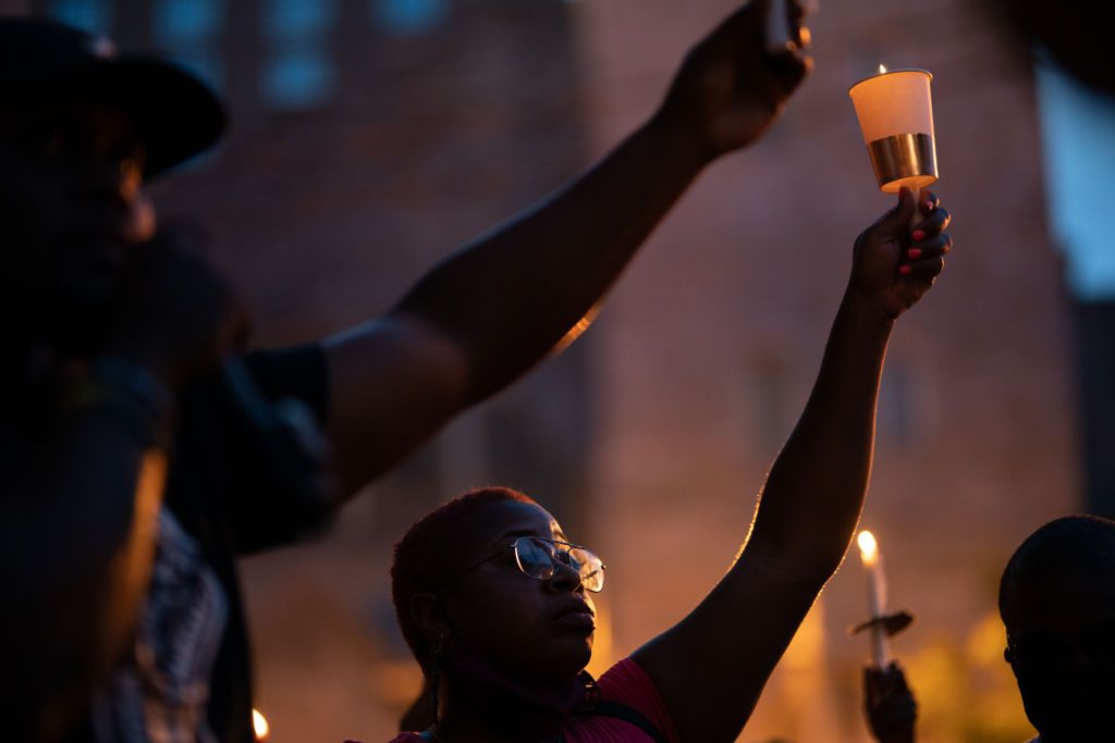 People take part in a candlelight vigil for U.S. Rep John Lewis on July 19, 2020 in Atlanta, Georgia.
