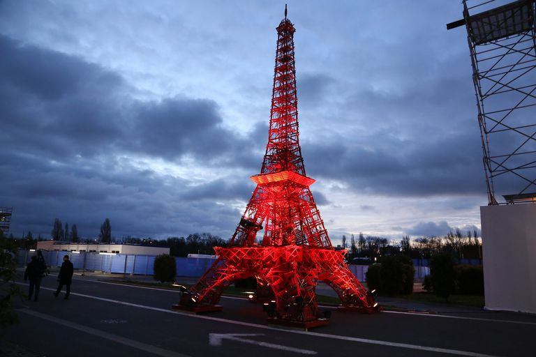 lit up miniature Eiffel Tower at COP21