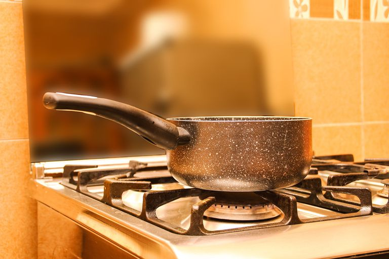 Water boiling in a pot on a stove.