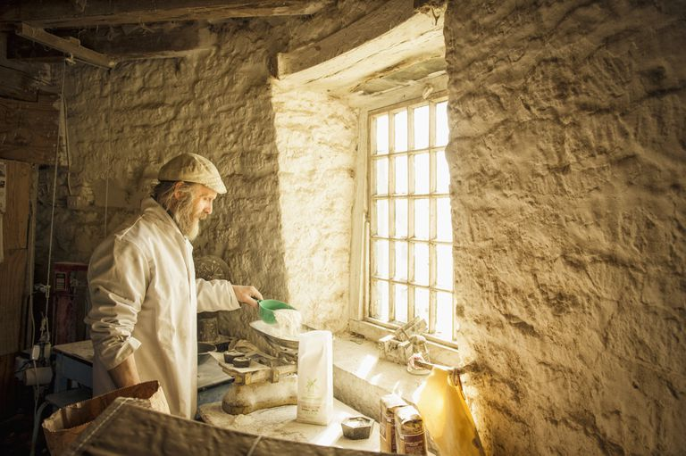 Caucasian artisan working in flour mill