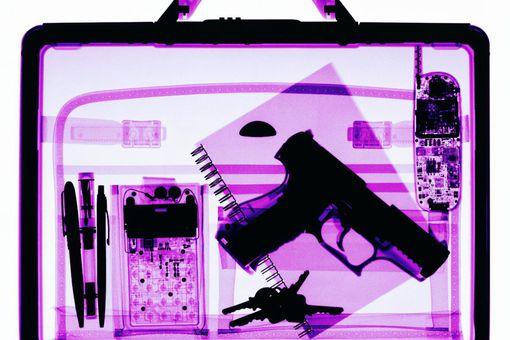 X-ray image of briefcase containing hand gun