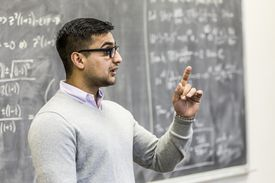 Professor talking in college classroom