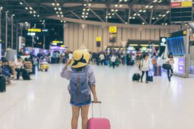 Woman arrives at the airport