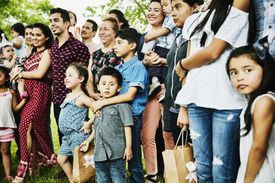 Multigenerational Latino family posing for family photo at birthday party