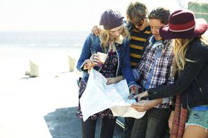 Young people looking at a map