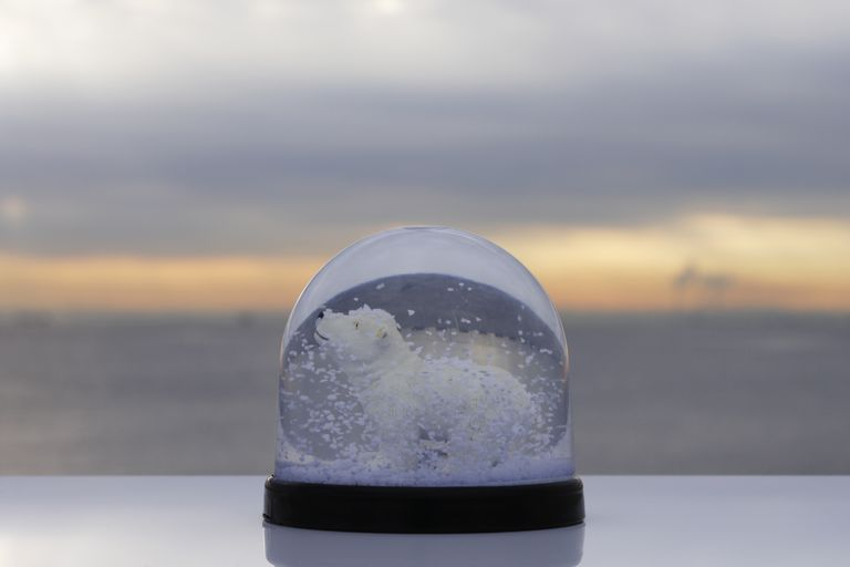 You could use glitter for a snow globe, but crystals will look more realistic.