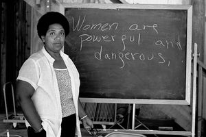 Audre Lorde Standing by a Blackboard With the Statement,