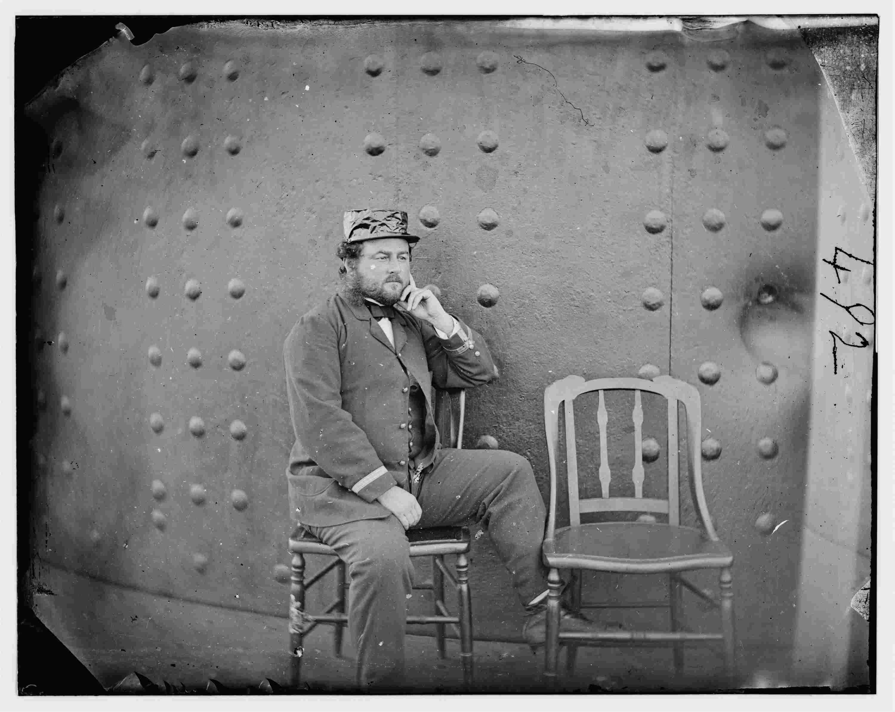Capt. William Nicholson Jeffers, in a photograph which shows battle damage to the Monitor's turret.