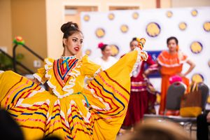 Woman dancing in colorful dress