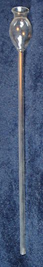 A thistle tube is a piece of glassware with a long tube with a reservoir and funnel-like opening.