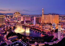 City skyline at night with Bellagio Hotel water fountains, Las Vegas, Nevada.
