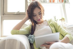 A woman reading her ipad